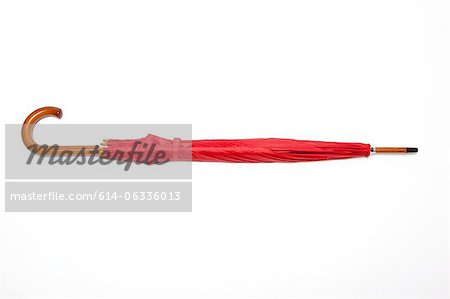 Red umbrella Stock Photo - Premium Royalty-Free, Image code: 614-06336013