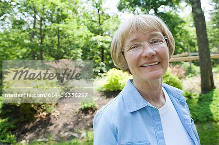 Woman in garden Stock Photo - Premium Royalty-Free, Image code: 614-06336297