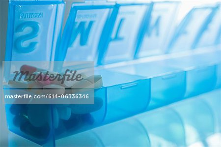 Pills in pillbox Stock Photo - Premium Royalty-Free, Image code: 614-06336346