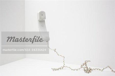 Telephone handset Stock Photo - Premium Royalty-Free, Image code: 614-06336424