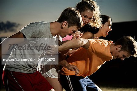 Friends playing soccer at night Stock Photo - Premium Royalty-Free, Image code: 614-06402573