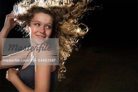 Portrait of girl with hand in hair Stock Photo - Premium Royalty-Free, Image code: 614-06402587