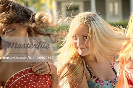 Girls with long hair in sunlight Stock Photo - Premium Royalty-Free, Image code: 614-06402667