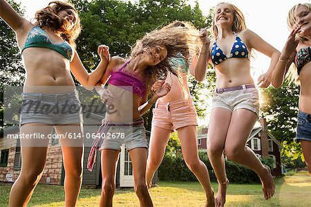 Girls dancing in garden Stock Photo - Premium Royalty-Free, Image code: 614-06402678