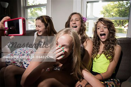 Group of girls being photographed with camera phone Stock Photo - Premium Royalty-Free, Image code: 614-06402696