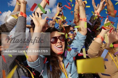 People cheering at a music festival Stock Photo - Premium Royalty-Free, Image code: 614-06402709
