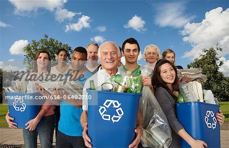 Group of people with recycling in bins Stock Photo - Premium Royalty-Free, Image code: 614-06402710