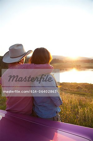 Couple looking at sunset Stock Photo - Premium Royalty-Free, Image code: 614-06402863