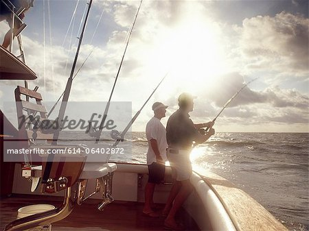 Men fishing from sport fishing boat Stock Photo - Premium Royalty-Free, Image code: 614-06402872