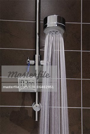 Shower with timer and running water Stock Photo - Premium Royalty-Free, Image code: 614-06402951