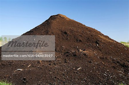 Mound of topsoil in commercial sandpit Stock Photo - Premium Royalty-Free, Image code: 614-06403007