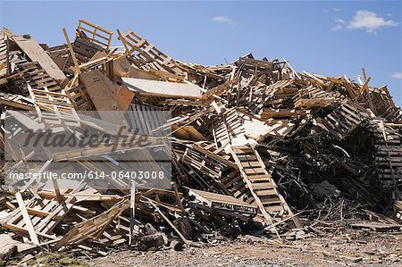 Pile of discarded wood at waste management site Stock Photo - Premium Royalty-Free, Image code: 614-06403008