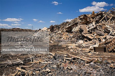 Pile of discarded wood at waste management site Stock Photo - Premium Royalty-Free, Image code: 614-06403009