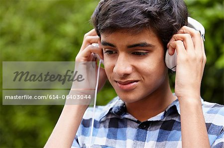 Teenage boy listening to music Stock Photo - Premium Royalty-Free, Image code: 614-06403044