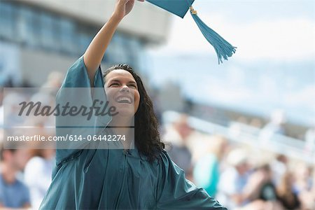 Happy female graduate Stock Photo - Premium Royalty-Free, Image code: 614-06442274