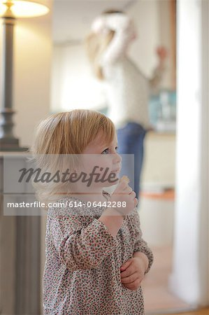 Portrait of toddler eating snack Stock Photo - Premium Royalty-Free, Image code: 614-06442288