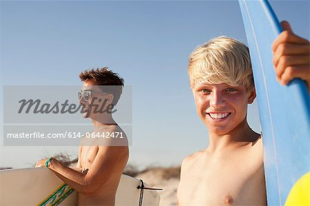 Two young men with surfboards Stock Photo - Premium Royalty-Free, Image code: 614-06442471