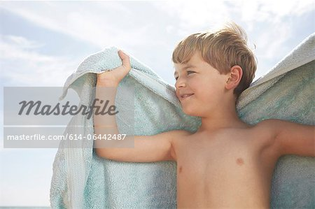 Boy outdoors with a towel Stock Photo - Premium Royalty-Free, Image code: 614-06442487