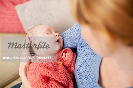 Mother holding newborn daughter Stock Photo - Premium Royalty-Free, Image code: 614-06442569