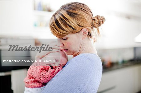 Mother holding newborn daughter Stock Photo - Premium Royalty-Free, Image code: 614-06442570