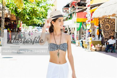 Young woman walking down street Stock Photo - Premium Royalty-Free, Image code: 614-06442651