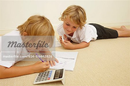Two schoolboys doing homework Stock Photo - Premium Royalty-Free, Image code: 614-06442826