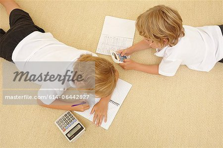 Two schoolboys doing homework Stock Photo - Premium Royalty-Free, Image code: 614-06442827