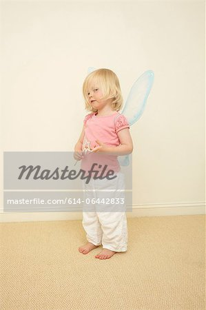 Toddler wearing wings, holding wand Stock Photo - Premium Royalty-Free, Image code: 614-06442833