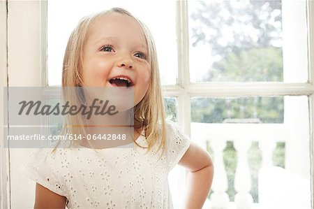 Happy little girl talking Stock Photo - Premium Royalty-Free, Image code: 614-06442848