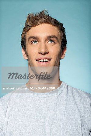 Portrait of man looking up Stock Photo - Premium Royalty-Free, Image code: 614-06442898