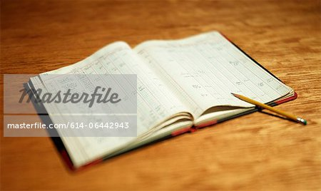 Open account book on wooden desktop Stock Photo - Premium Royalty-Free, Image code: 614-06442943