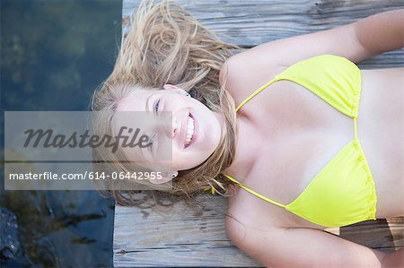 Girl lying on jetty Stock Photo - Premium Royalty-Free, Image code: 614-06442955