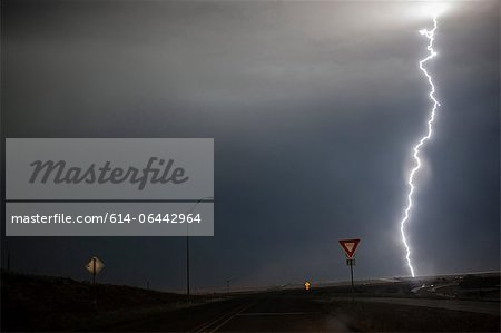 Lightning above a road Stock Photo - Premium Royalty-Free, Image code: 614-06442964