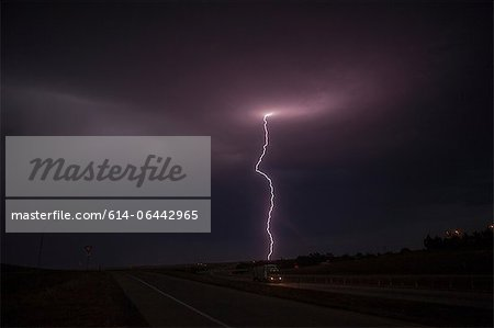 Lightning above a road Stock Photo - Premium Royalty-Free, Image code: 614-06442965