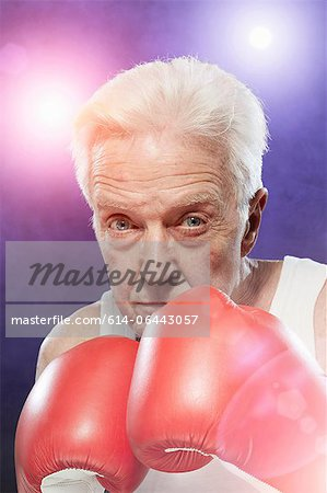 Senior man in boxing gloves Stock Photo - Premium Royalty-Free, Image code: 614-06443057