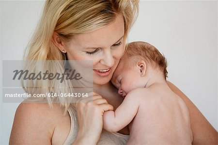 Mother holding newborn baby boy Stock Photo - Premium Royalty-Free, Image code: 614-06443064