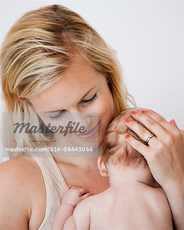 Mother holding newborn baby boy Stock Photo - Premium Royalty-Free, Image code: 614-06443066
