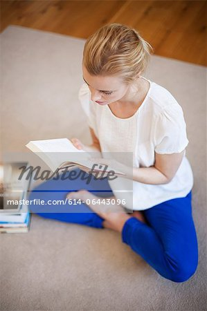 Young woman reading a book Stock Photo - Premium Royalty-Free, Image code: 614-06443096
