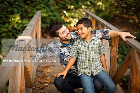 Father and son playing on wooden bridge Stock Photo - Premium Royalty-Free, Image code: 614-06536736