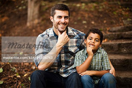 Father and son sitting on stone steps Stock Photo - Premium Royalty-Free, Image code: 614-06536743