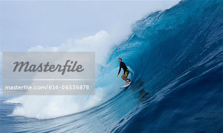 Man surfing in curl of wave Stock Photo - Premium Royalty-Free, Image code: 614-06536878