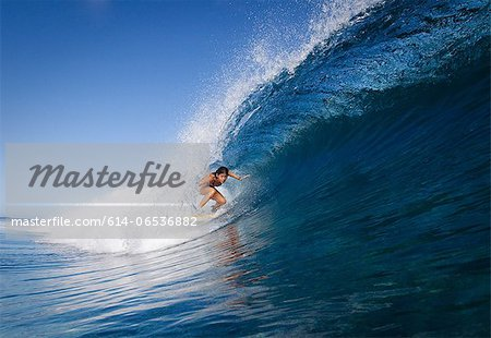 Woman surfing in crest of wave Stock Photo - Premium Royalty-Free, Image code: 614-06536882