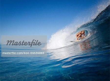 Woman surfing in crest of wave Stock Photo - Premium Royalty-Free, Image code: 614-06536883