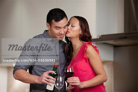Couple having wine together in kitchen Stock Photo - Premium Royalty-Free, Image code: 614-06536941
