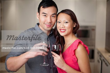 Couple toasting each other with wine Stock Photo - Premium Royalty-Free, Image code: 614-06536943