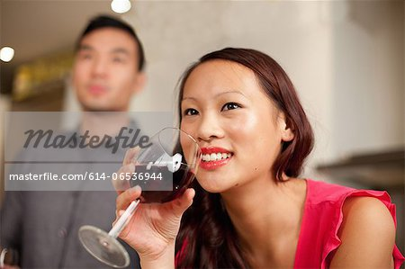 Woman drinking wine in kitchen Stock Photo - Premium Royalty-Free, Image code: 614-06536944