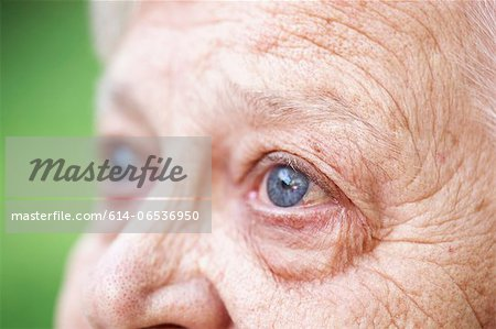 Close up of older woman's blue eye Stock Photo - Premium Royalty-Free, Image code: 614-06536950