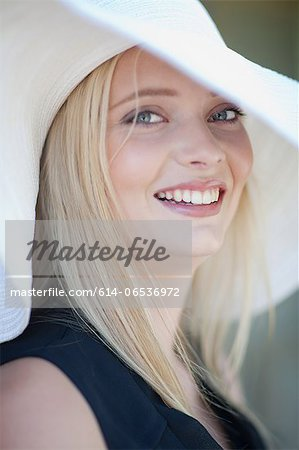 Smiling woman wearing hat Stock Photo - Premium Royalty-Free, Image code: 614-06536972