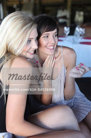 Women posing for picture on sofa Stock Photo - Premium Royalty-Free, Image code: 614-06536980