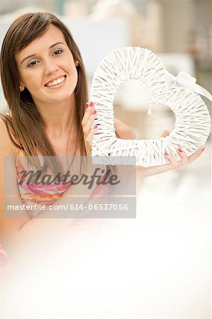 Smiling woman shopping in store Stock Photo - Premium Royalty-Free, Image code: 614-06537056